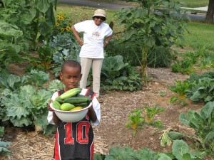 Ms. Kidd and a boy with their harvest.