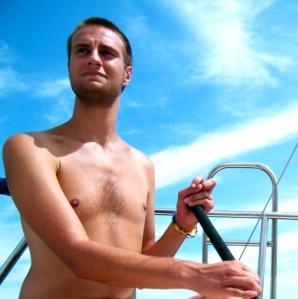 "Josh Stieber sailing on Oliver Hardy's ""Class Struggle"" in the Sandusky Bay."